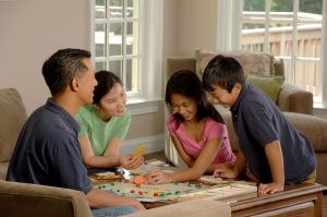 family-playing-monopoly